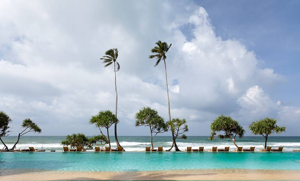 View of The Fortress Resort And Spa's Swimming Pool By the Beach